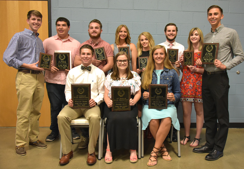 students holding plaques