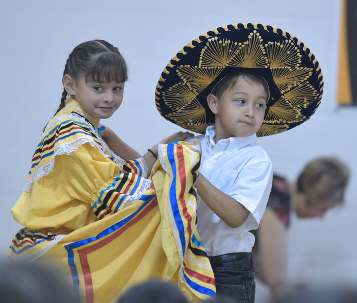 boy and girl dancer in folklorico costume